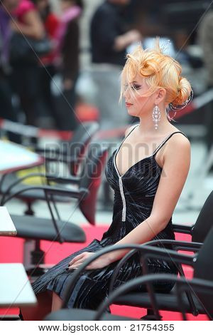 MOSCOW - OCTOBER 2: Blonde model with fanciful hairdo at XVII International Festival