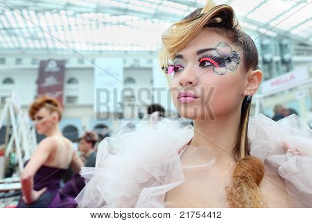 MOSCOW - OCTOBER 2: Model with unusual hairstyle and beautiful make-up at XVII International Festival