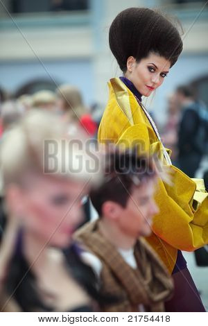 MOSCOW - OCTOBER 2: Brunette model with unusual hairstyle wear kimono at XVII International Festival