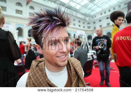 MOSCOW - OCTOBER 2: Man with original hairstyle with violet strand at XVII International Festival