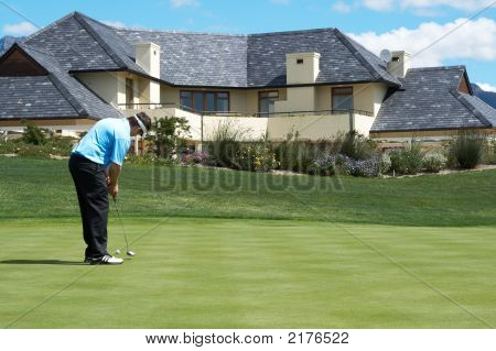 Golfer On The Putting Green