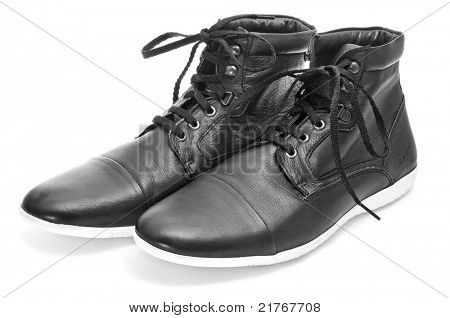 casual black leatherette boots on a white background
