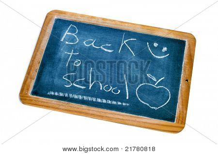 sentence back to school written in a blackboard