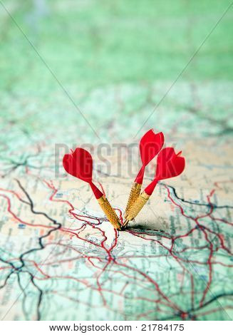 Green map with three red darts - shallow focus