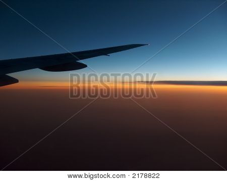 Airplane Wing In The Sunset