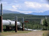 foto of trans  - The Trans-Alaska Pipeline winds through the Alaska Range south of Delta Junction on the Richardson Highway