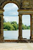 stock photo of hever  - old arches Hever castle gardens Hever England with view of the lake - JPG