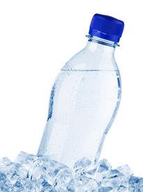 stock photo of bottle water  - Water bottle in ice - JPG