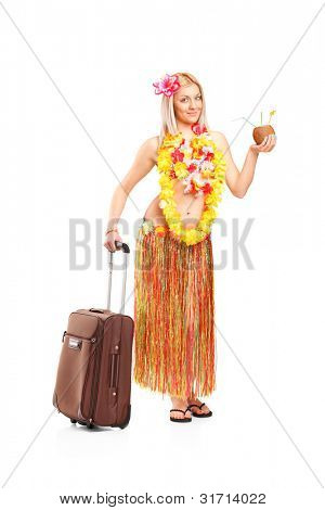 Full length portrait of an attractive young woman dressed in a hawaiian costume going on vacation isolated on white background