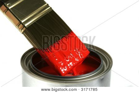 Paint Brush Dipped Into Red Paint
