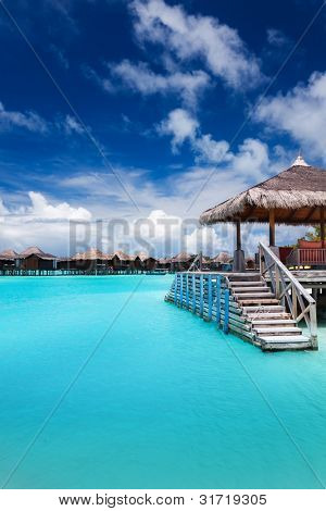 Jetty with steps into amazing tropical blue lagoon