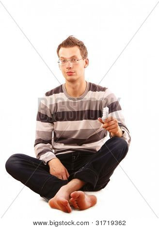 A young man sitting on the floor, isolated on white background