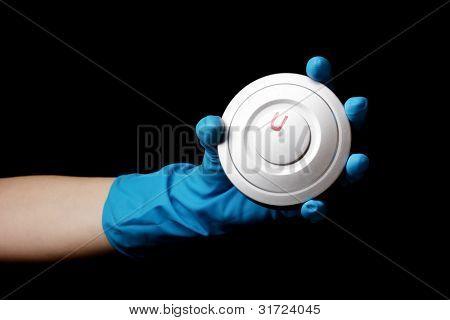 Uranium in hand isolated on black