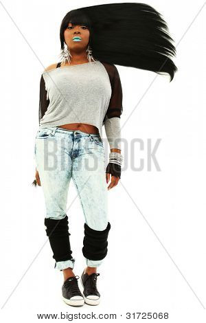 Attractive Black Female With Long Flowing Hair Wearing Jeans