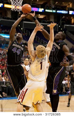 LOS ANGELES - MARCH 12: Arizona Wildcats C Kyryl Natyazhko #1 (C) Washington Huskies F Darnell Gant #44 (L) & Huskies C Aziz N'Diaye #5 (R) during the NCAA Pac-10 Tournament game on March 12 2011