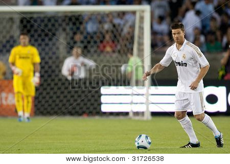 LOS ANGELES - JULY 16: Real Madrid C.F. M Xabi Alonso #14 in action during the World Football Challenge game on July 16 2011 at the Los Angeles Memorial Coliseum in Los Angeles.