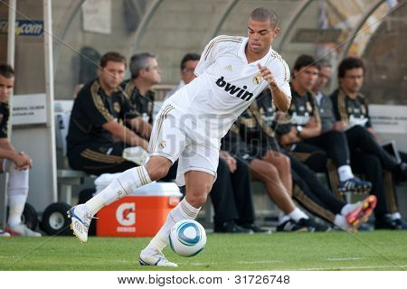 LOS ANGELES - JULY 16: Real Madrid C.F. D Pepe #3 tries to keep the ball inbounds during the World Football Challenge game on July 16 2011 at the Los Angeles Memorial Coliseum in Los Angeles.