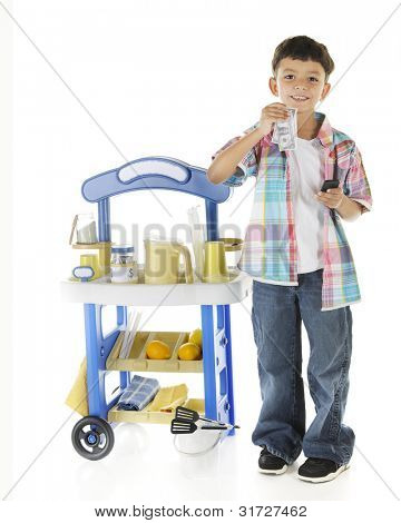 An adorable preschooler delighted with the money he's making from his lemonade stand.  On a white background.