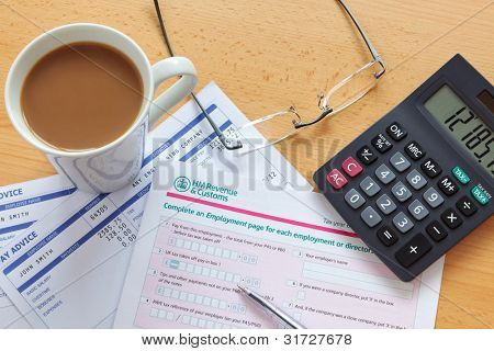 Still life photo of a UK employment tax return. The payslip is a mock up the names and all other information on it is fictional.