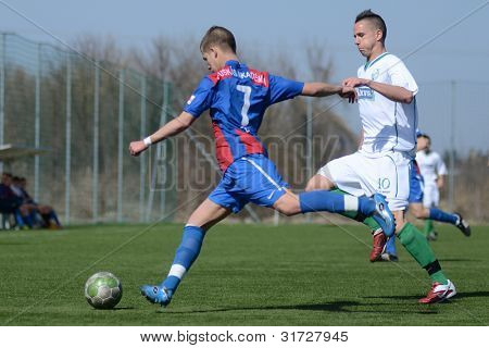 KAPOSVAR, HUNGARY - MARCH 17: Marton Lorentz (blue) in action at the Hungarian National Championship under 18 game between Kaposvar (white) and Videoton (blue), March 17, 2012 in Kaposvar, Hungary.