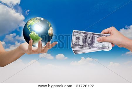 Hand exchange the world with Dollar over blue sky (Elements of this image furnished by NASA)