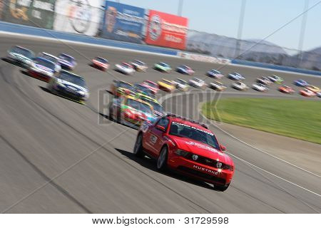 FONTANA, CA. - OCT 10: The Ford Mustang pace car leads the way during the Pepsi Max 400 on Oct 10 2010 at the Auto Club Speedway.