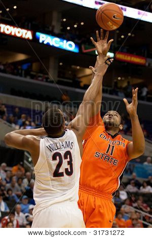 LOS ANGELES - MARCH 10: Oregon State Beavers C Joe Burton #11 & Arizona Wildcats F Derrick Williams #23 during the NCAA Pac-10 Tournament basketball game on March 10 2011 at Staples Center.