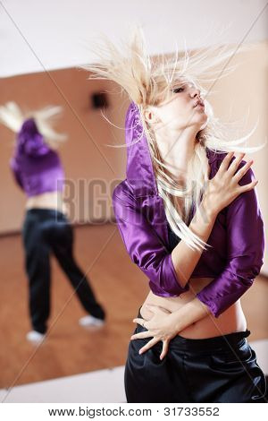 Teenage girl dancing hip-hop in gym classroom