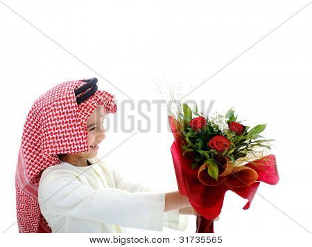 Arabian cute child holding flowers