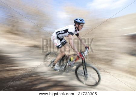 CLUJ-NAPOCA, ROMANIA - MARCH 24: Unidentified competitor during the Clujul Pedaleaza mountain bike competition, 1st stage