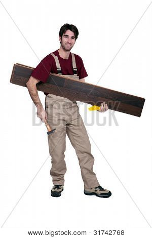 Worker carrying flooring