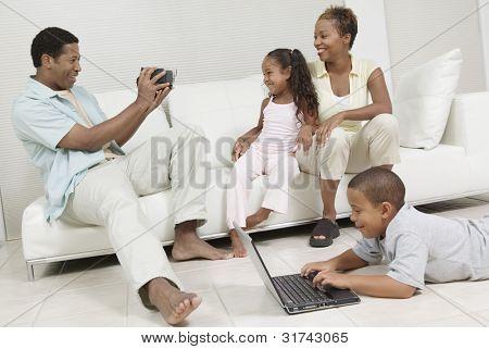 Man Videotaping Family