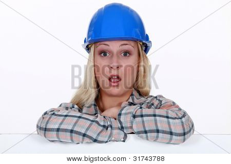 A surprised construction worker