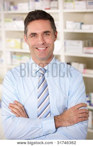 Portrait UK pharmacist at work