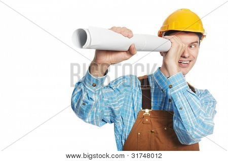 Smiling young happy builder worker in protective hardhat and workwear overall with drafts plans isolated