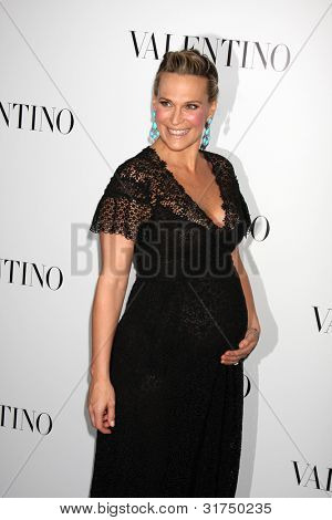 LOS ANGELES - MAR 27:  Molly Sims arrives at the Valentino Beverly Hills Opening at the Valentino Store on March 27, 2012 in Beverly Hills, CA