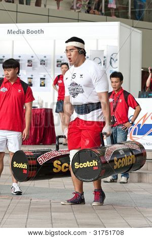 TOA PAYOH, SINGAPORE - MARCH 24 : Contender for Strongman Benjamin Soh attempts the 2 times 120 log walk in the Strongman Challenge 2012 on March 24, in Toa Payoh Hub, Singapore.