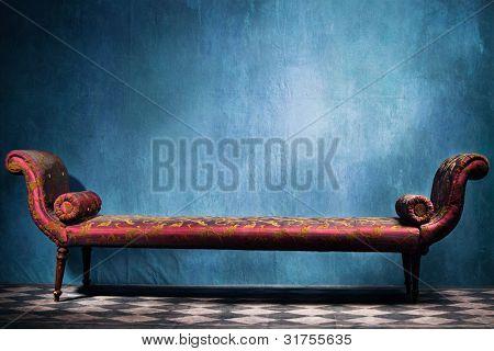 elegant long  recamie in blue room with tiled floor