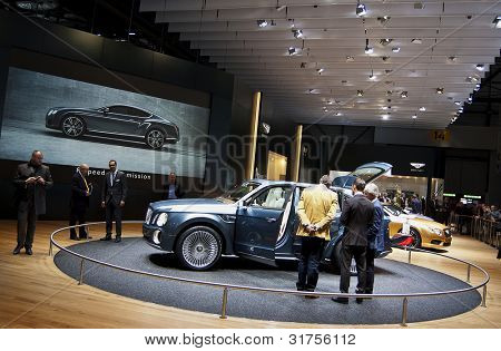 GENEVA SWITZERLAND - MARCH 12: The Bentley Stand displaying a full view of the new Bentley 4x4 Concept, at the Geneva Motorshow on March 12th, 2012 in Geneva, Switzerland.