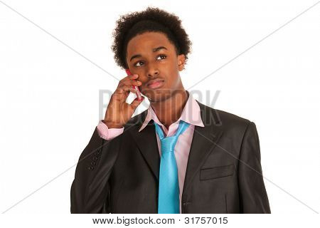 Young black business man with mobile phone in studio