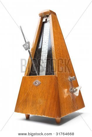 Vintage metronome music timer on a white background.
