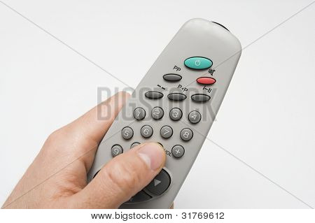 remote in hand over white