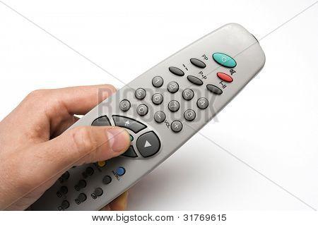 remote in hand over white
