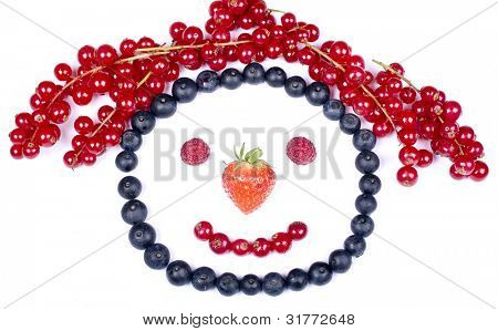funny figurine with fresh berries. smile