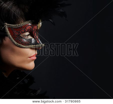 Portrait of elegant woman  with venetian mask