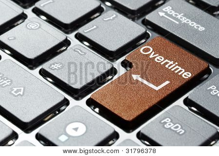 Brown overtime button on the keyboard