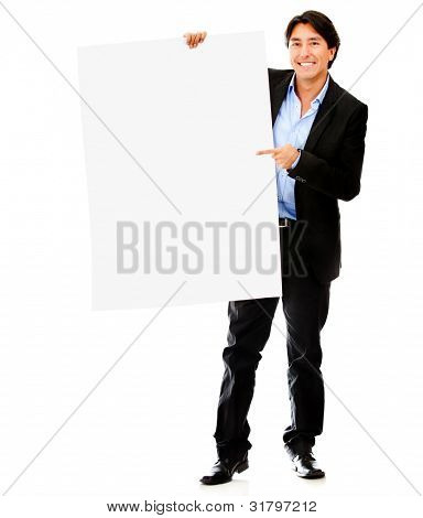 Businessman pointing at a banner - isolated over a white background