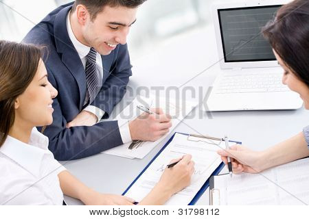 Image of four business people working at meeting