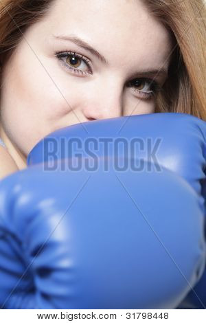 young attractive woman boxer over white