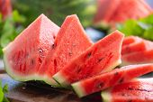 Summer ripe sliced watermelon. Juicy slice of ripe watermelon, close-up. Concept summer ripe berry o poster